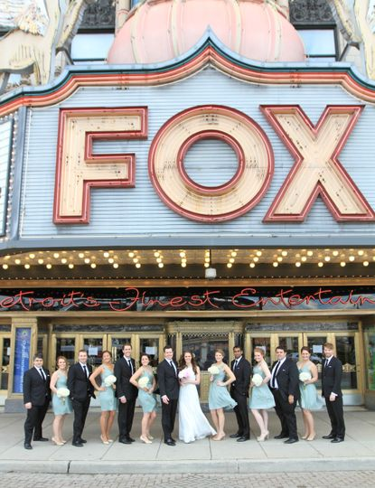 Wedding party outside of a theater