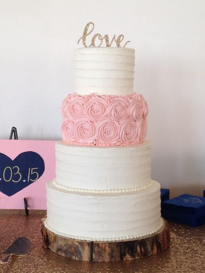 Four layered cake with love on top