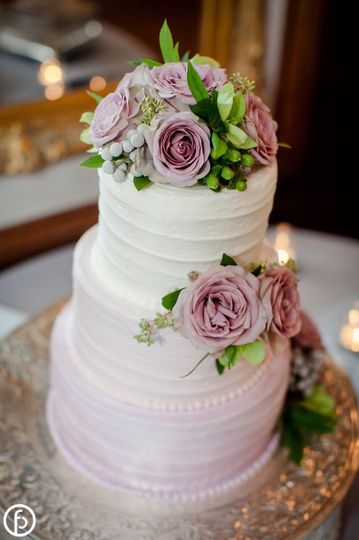 Gradient wedding cake with lavender flowers