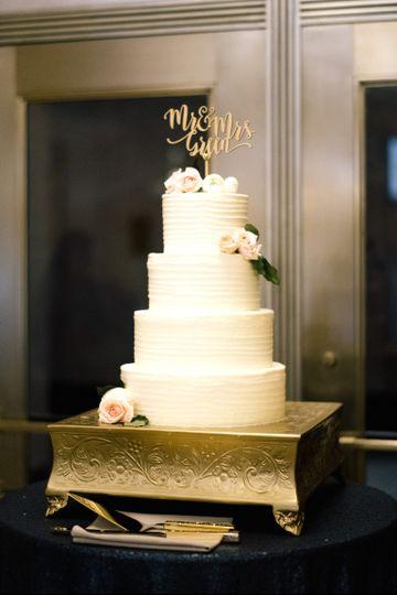 White wedding cake with minimal flower design