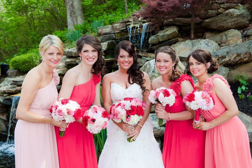 bride and maids at waterfall in coral