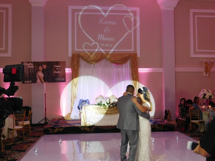 First dance as husband and wife with monogram in the background