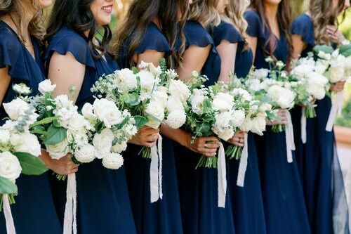 Wedding party with matching gowns and flowers