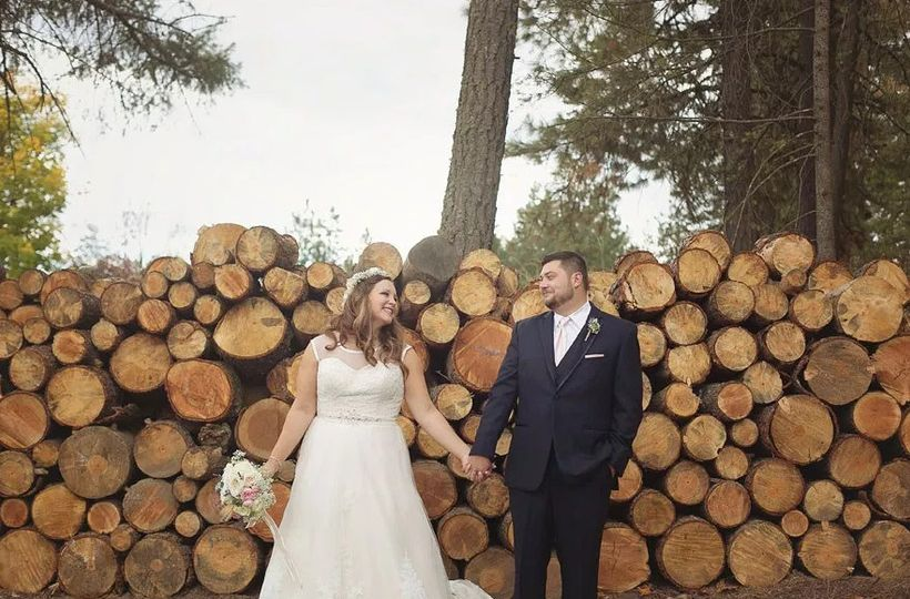 Newlyweds by the logs