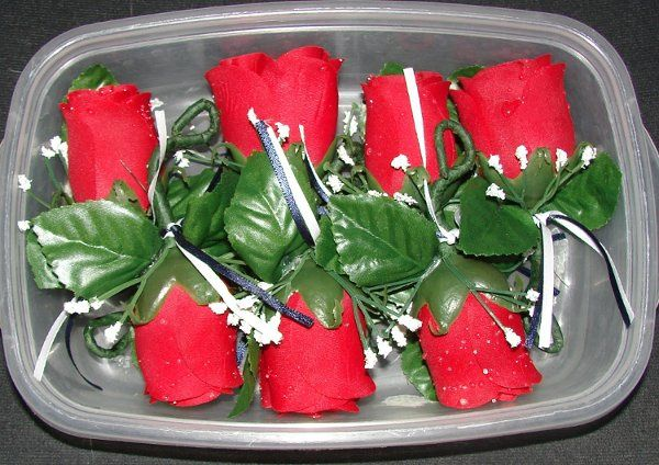 These are the red rose boutonniere's I made for my very own upcoming wedding.