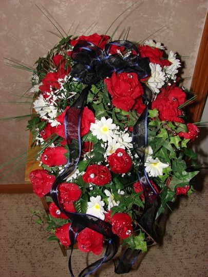 again for my wedding. They are made up of red roses, white daisies, baby's breath, and english ivy.