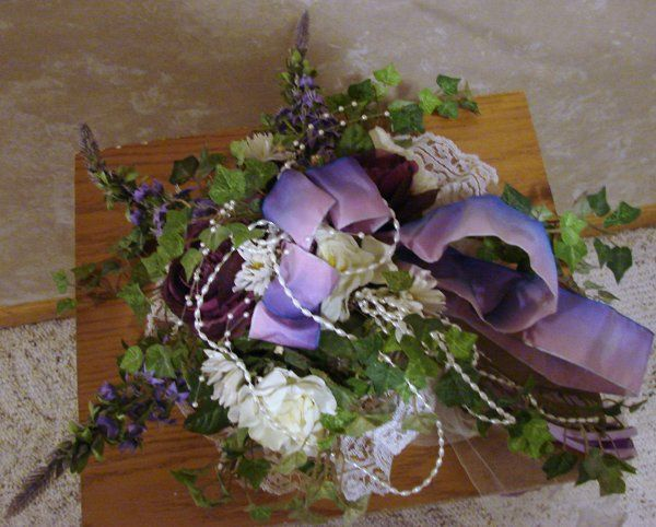 of english ivy, accented with mauve and blue flowers