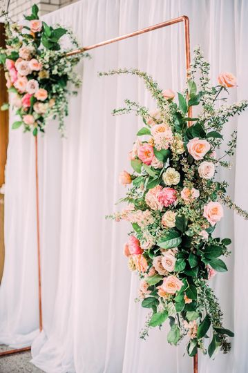 Copper arch ceremony flowers
