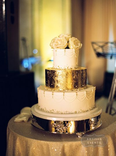 Three tier white and gold wedding cake