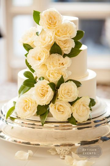 Three tier wedding cake with white roses