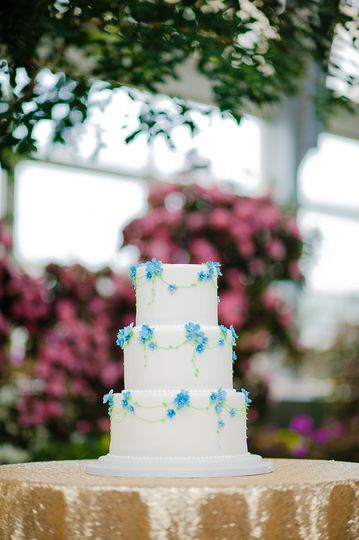 Three tier blue and white cake