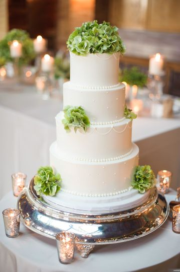 Four tier wedding cake with green flowers