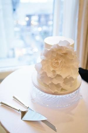 Two tier wedding cake with large white flower