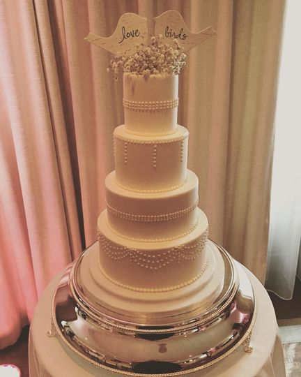 Four tier tall wedding cake