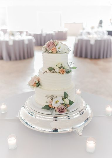 Three tier wedding cake with flowers