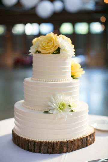 Three tier wedding cake with yellow flowers