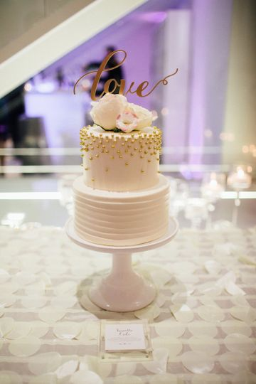 Two tier wedding cake with love on top