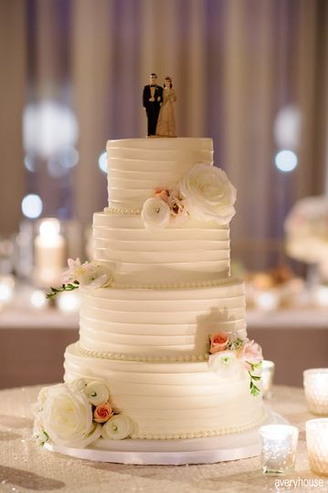 Four tier wedding cake with white flowers