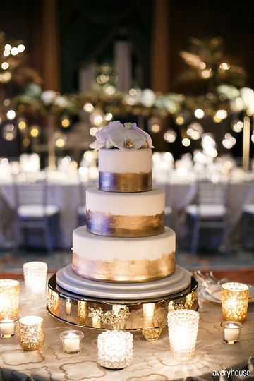 Three tier white and gold cake