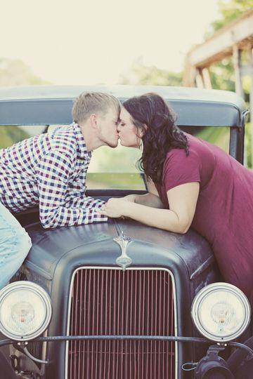 A kiss over a vintage car