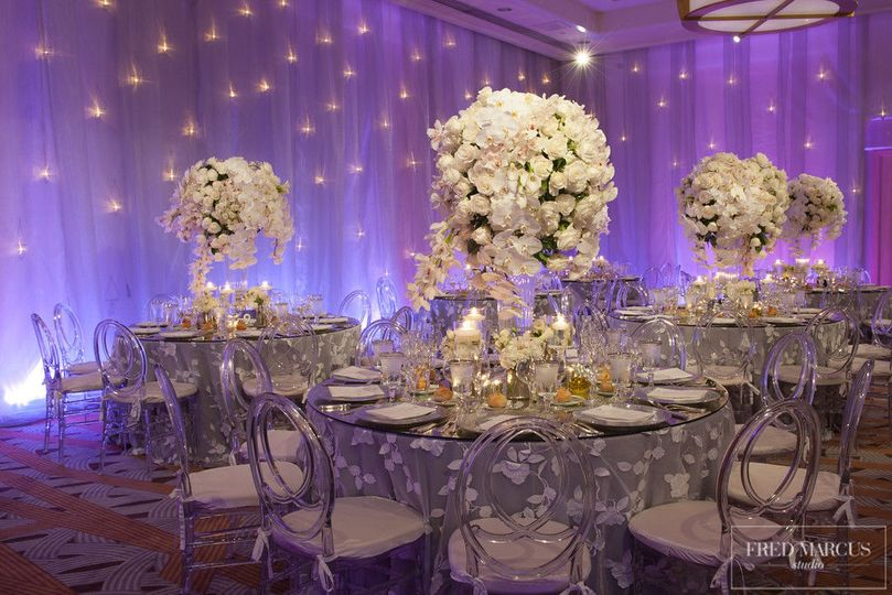 Large white flower centerpiece with formal table set-up