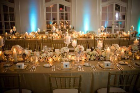Table setting with floral and candle centerpiece