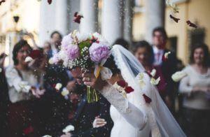 Bride holding out bouquet