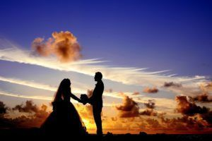 Silhouette of newlyweds against the sunset