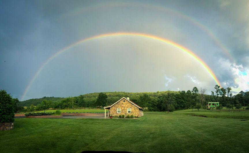 Rainbow over barn