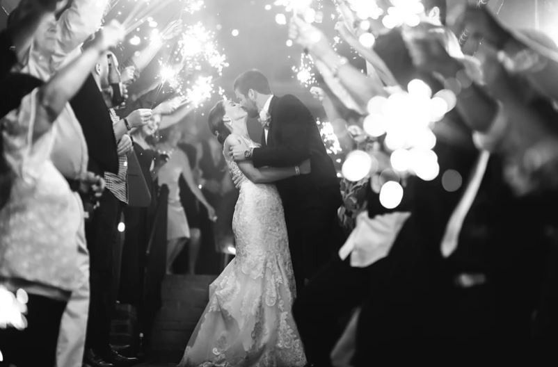 Kiss under the sparklers - Megan Sheppard Photography
