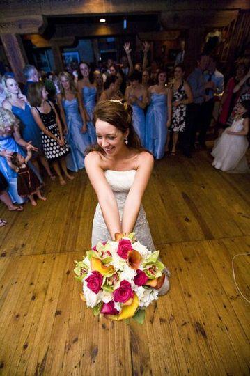 Bride tossing a bouquet