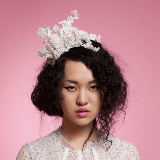 Dramatic headpiece of stiffened French lace - 'Aimee' - by Cappellino Millinery
