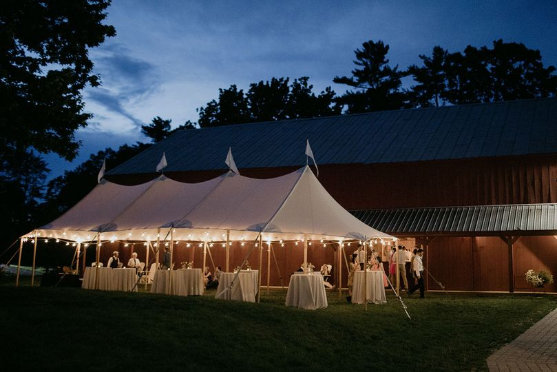 Reception tent setup outside the barn
