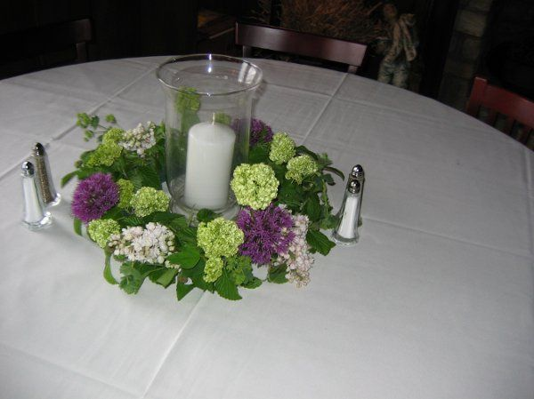 Oasis ring with Hurricane candle, snowball, lilac, allium