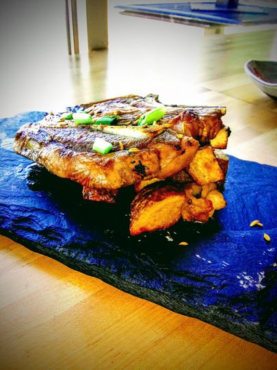 T-Bone on a bed of potatoes