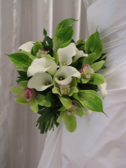 Hand tied bouquet of green and wihte calla lilies with accents of green orchids. Simply stunning!