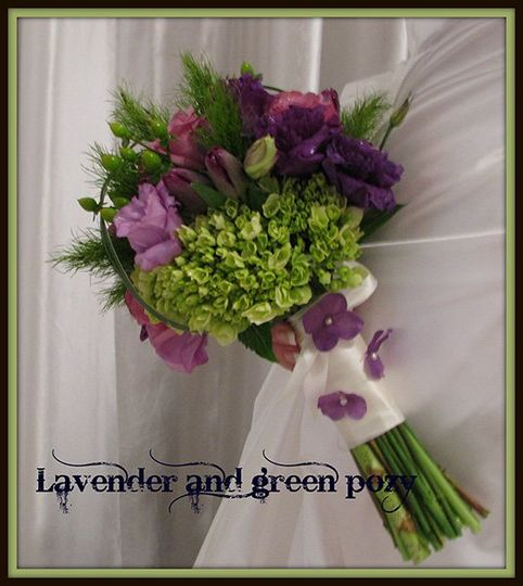 Beautiful hand tied pozy in lavender and green....with a custom tied handle.