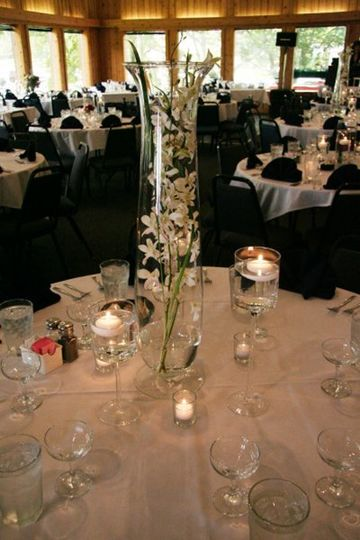 Orchids in glass with candle light.