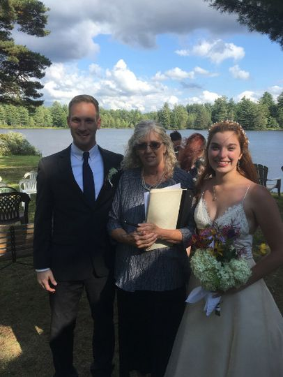 Officiant and the newlywed couple