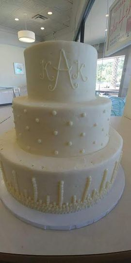 3-tier cake with dotted and detailed tiers
