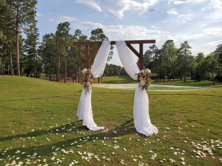 Drapery on wedding arch