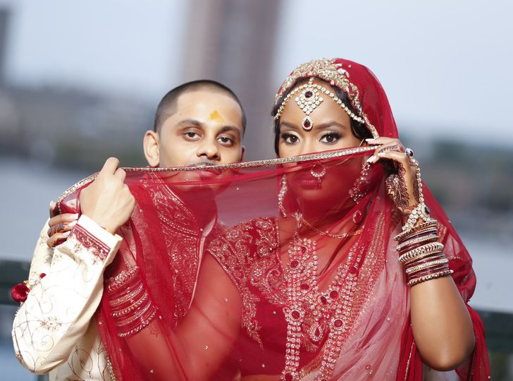 Couple hide behind the bride's veil