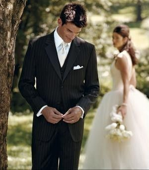 Elegant pin-stripe black tuxedo crafted from a Super 100's fabric with a traditional silhouette....