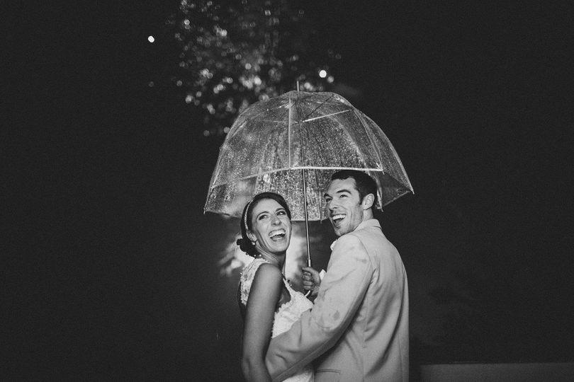 Newlyweds under an umbrella