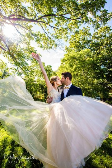 Groom carries his bride