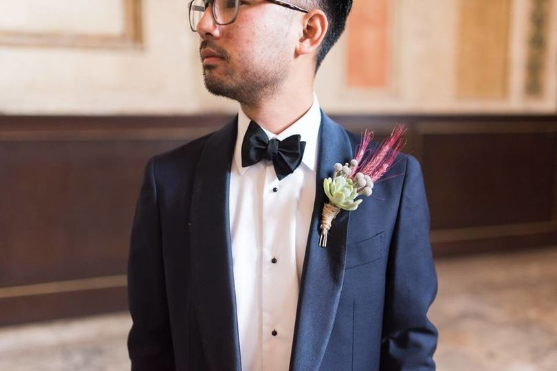 Groom in a tuxedo with boutonniere