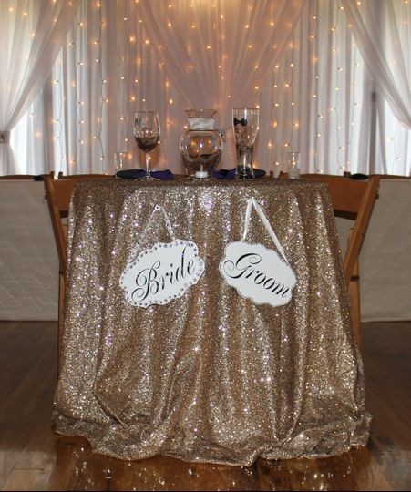 bride and groom hanging signs w brooch