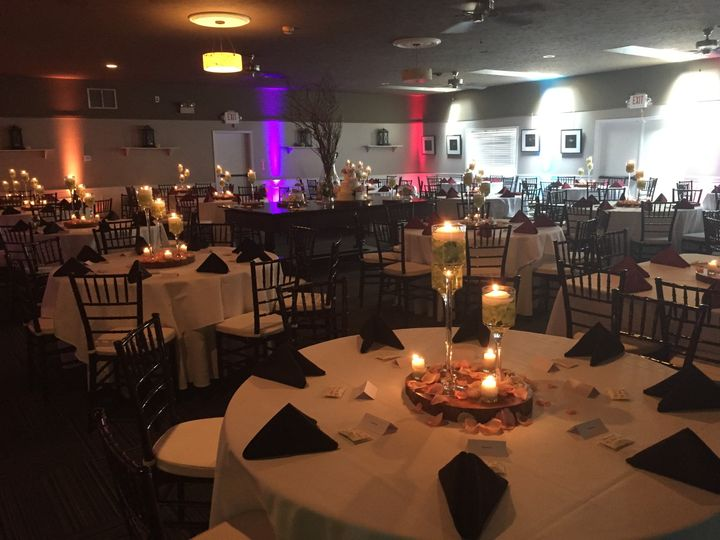 Candlelit tables and reception uplights