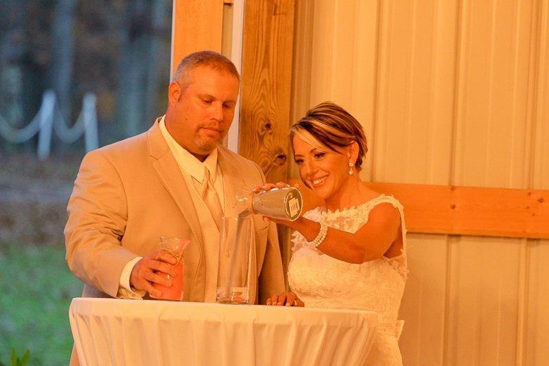 Newlyweds pour a glass