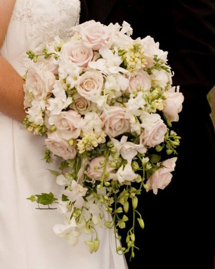 Please visit our website, www.thegardenofedenflowers.com, to view more of our personal designs!...
